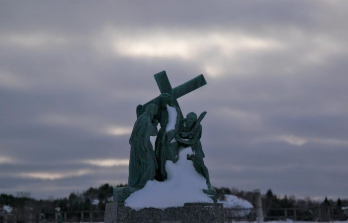 A cross covered in snow, from the Prey documentary